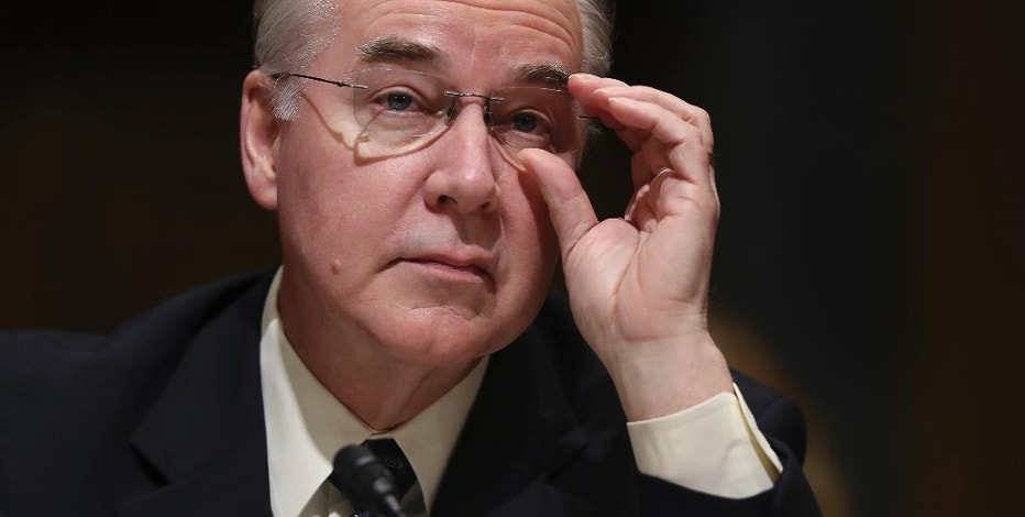 FILE - In this Jan. 24, 2017 file photo, Health and Human Services Secretary-designate, Rep. Tom Price, R-Ga. pauses while testifying on Capitol Hill in Washington at his confirmation hearing before the Senate Finance Committee. Republicans are ready to overpower Democrats and push President Donald Trump's next Cabinet nominee through the Senate, the man who will help lead the GOP drive to erase and replace the health care law. The Senate voted 51-48 Wednesday, Feb. 8, 2017, to short-circuit Democratic delaying tactics against Price, Trump's choice for health secretary. (AP Photo/Andrew Harnik, File)