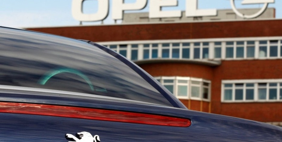 A Peugeot car is pictured at the Opel plant in Bochum October 22, 2012. Opel's U.S. parent company General Motors will post third-quarter results on October 31.  REUTERS/Ina Fassbender/File Photo
