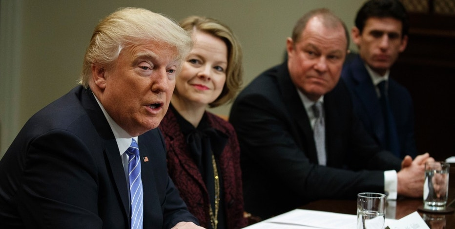 President Donald Trump speaks during a meeting with retail industry leaders in the Roosevelt Room of the White House in Washington, Wednesday, Feb. 15, 2017. From left are, Trump, Jo-Ann Craft Stores CEO Jill Soltau, Gap Inc. CEO Art Peck, and Jeremy Katz, an adviser to National Economic Council Director Gary Cohn. (AP Photo/Evan Vucci)