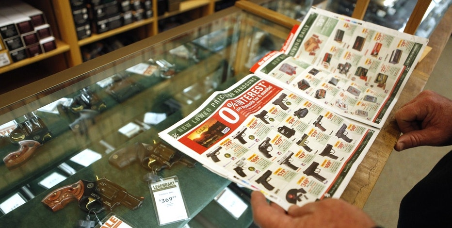 "A customer looks through the in-store sales advertisements inside a Cabela's store on the shopping day dubbed ""Black Friday"" in Fort Worth, Texas November 27, 2009."