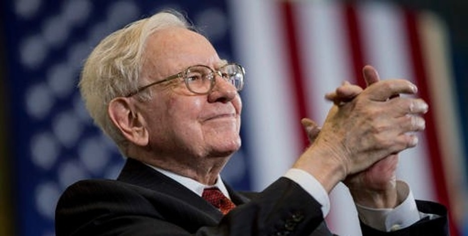 Warren Buffett criticises Wall Street as Apple investment pays off
