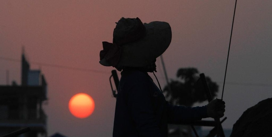 FILE - In this Feb. 22, 2016 file photo, a construction worker is silhouetted while working at a construction site in Roang Chak village, in Phnom Penh, Cambodia. Developing countries in Asia and the Pacific will need to invest up to $1.7 trillion a year, or $26 trillion through 2030, to meet their infrastructure needs and to maintain the region's growth momentum — more than double the previous estimate in 2009, an Asian Development Bank report said Tuesday, Feb. 28, 2017. (AP Photo/Heng Sinith, File)