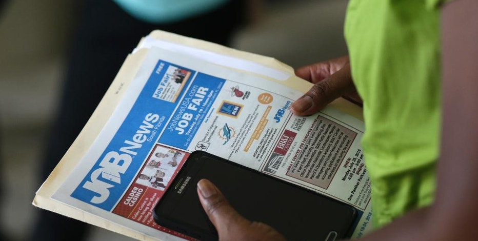 FILE - In this Tuesday, July 19, 2016, file photo, a job applicant attends a job fair in Miami Lakes, Fla.  The Labor Department says applications for jobless aid rose by 20,000 to a seasonally adjusted 243,000, up from a 44-year-low 223,000 the week before, on Thursday, March 9, 2017. The four-week average, which is less volatile, blipped up by 2,250 to 236,500. (AP Photo/Lynne Sladky, File)