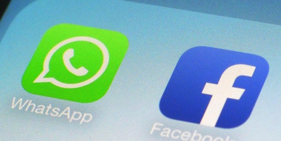 FILE - This Feb. 19, 2014, file photo, shows WhatsApp and Facebook app icons on a smartphone in New York.   So, you use messaging apps like WhatsApp or Signal or have smart TVs and PCs. Should you worry that the CIA is listening to your conversations? The short answer is no. The long answer is maybe, but it's unlikely. Revelations by WikiLeaks describing secret CIA hacking tools the government uses to break into computers, mobile phones and even smart TVs, if true, could certainly have real-life implications for anyone who uses internet-connected technology.(AP Photo/Patrick Sison, File)
