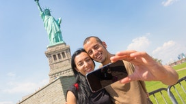 U.S. Tourism Sector Faces Squeeze of Strong Dollar, Trump Travel Ban