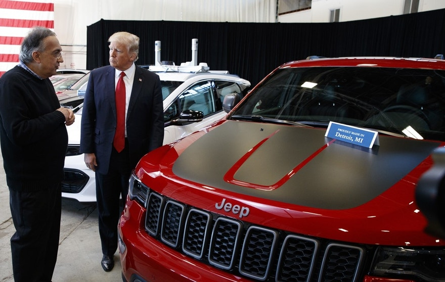 President Donald Trump talks with Fiat Chrysler CEO Sergio Marchionne during a tour at the American Center of Mobility, Wednesday, March 15, 2017, in Ypsilanti Township, Mich.