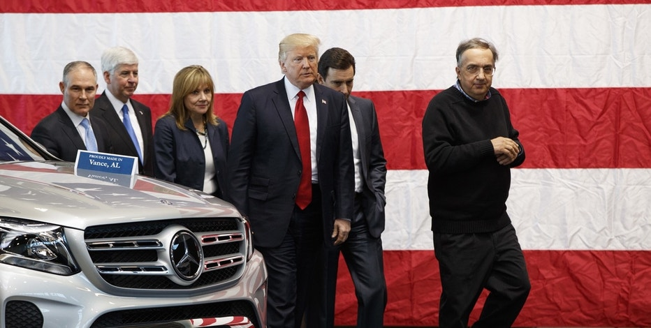 President Donald Trump tours the American Center of Mobility, Wednesday, March 15, 2017, in Ypsilanti Township, Mich. From left are, EPA administrator Scott Pruitt, Michigan Gov. Rick Snyder, GM CEO Mary Barra, Trump, Ford CEO Mark Fields, and Fiat Chrysler CEO Sergio Marchionne.