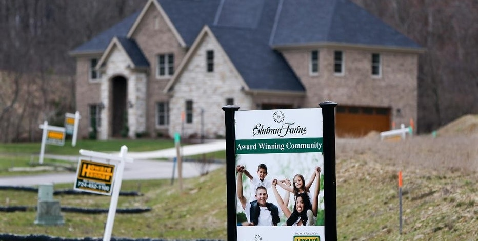In this Monday, Feb. 27, 2017, photo, real estate signs mark the lots near one of the new homes for sale in a development for new homes in Cranberry Township, Butler County, Pa. On Wednesday, March 15, 2017, the National Association of Home Builders/Wells Fargo releases its March index of builder sentiment. (AP Photo/Keith Srakocic)