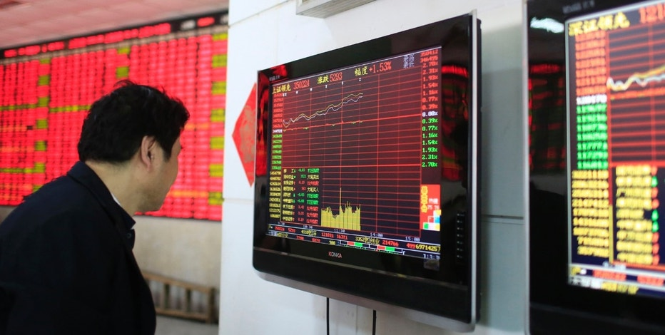 An investor looks at a computer screen showing stock information at a brokerage house in Shanghai March 17, 2015. REUTERS/Aly Song