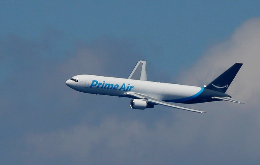 "A Boeing 767 with an Amazon.com ""Prime Air"" livery flies over Lake Washington, Friday, Aug. 5, 2016, as part of the Boeing Seafair Air Show. Amazon unveiled its first branded cargo plane Thursday, one of 40 freighters that will make up the company's own air transportation network of 40 Boeing jets leased from Atlas Air and Air Transportation Services Group, which will operate the air cargo network."