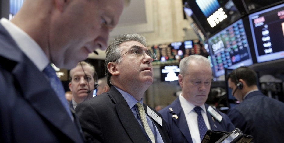 Wall St ends sharply lower on fears of tax cut delays