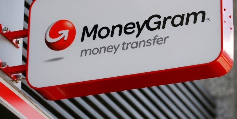 FILE PHOTO -  A Moneygram logo is seen outside a bank in Vienna, Austria, June 28, 2016. REUTERS/Heinz-Peter Bader/File Photo