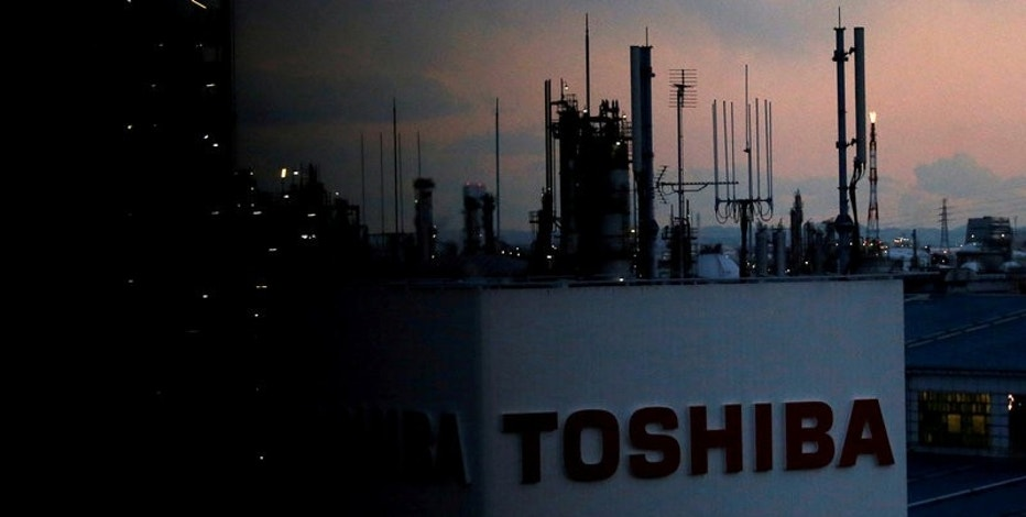 FILE PHOTO:  The logo of Toshiba Corp. is seen at the company's facility in Kawasaki, Japan February 13, 2017. REUTERS/Issei Kato/File Photo