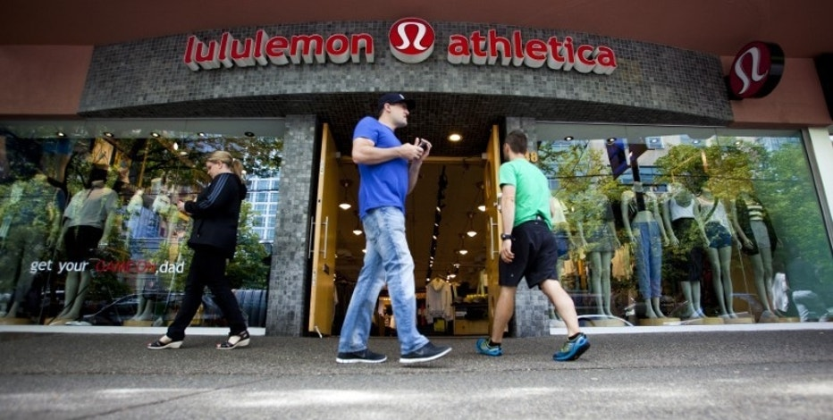 People walk past a store of yogawear retailer Lululemon Athletica in downtown Vancouver June 11, 2014. REUTERS/Ben Nelms