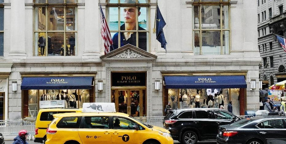 Traffic passes the Polo Ralph Lauren store on Fifth Avenue, Tuesday, April 4, 2017, in New York. Ralph Lauren Corp. said that it is shuttering the high-profile store less than three years after opening it. The closure is part of the New York fashion company's plan to save $140 million annually. The company said it will close other stores, cut jobs and shut some corporate offices, but did not provide details. (AP Photo/Mark Lennihan)