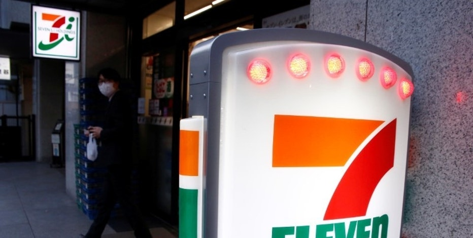 A man walks out of Seven & i Holdings Co's Seven Eleven convenience store in Tokyo, Japan January 12, 2017. REUTERS/Kim Kyung-Hoon