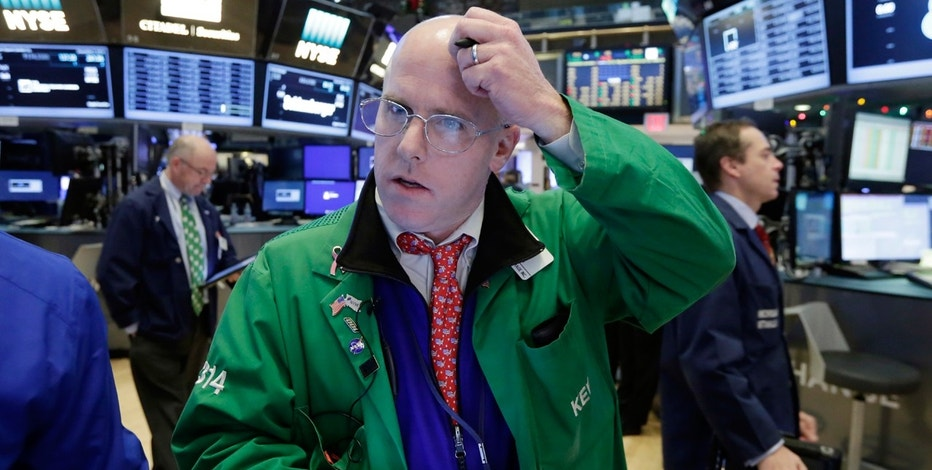 Wall St falls as investors weigh global risks, bank results