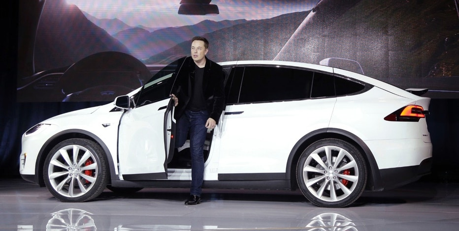 "FILE - In this Sept. 29, 2015 file photo, Elon Musk, CEO of Tesla Motors Inc., introduces the Model X car at the company's headquarters in Fremont, Calif. A Tesla in Autopilot mode can drive itself but it's not a ""self-driving"" vehicle, at least as far as safety regulators are concerned. So, instead of coming under heavy government scrutiny before being sold to the public, Tesla can mass-produce cars that automatically adjust speed with the flow of traffic, keep their lane and slam the brakes in an emergency. (AP Photo/Marcio Jose Sanchez, File)"