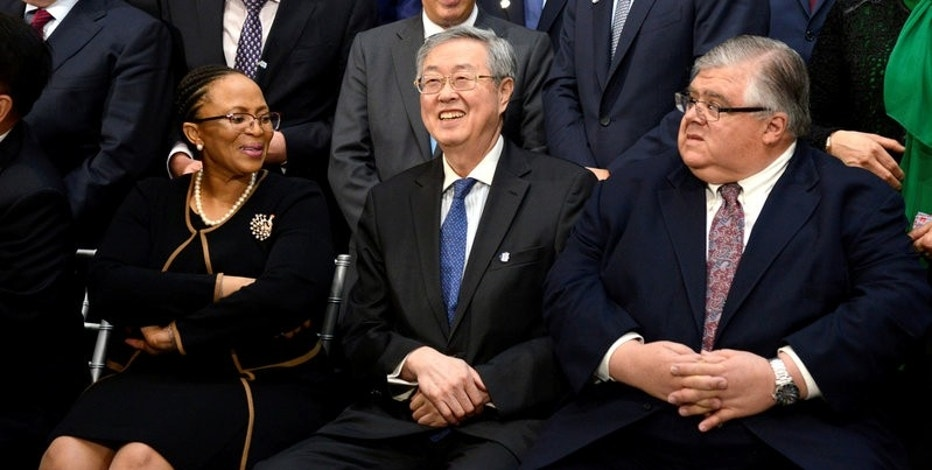 "People's Bank of China Governor Zhou Xiaochuan (C) is seated with Central Bank of Lesotho Governor Rets'elisitoe Adelaide Matlanyane (L) and Mexico's Finance Minister Agustin Carstens for a ""family"" photo for the International Monetary and Financial Committee (IMFC), as part of the IMF and World Bank's 2017 Annual Spring Meetings, in Washington, U.S., April 22, 2017.   REUTERS/Mike Theiler"
