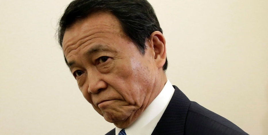 Japan's Aso pushes back on US call for scrutiny of currency moves