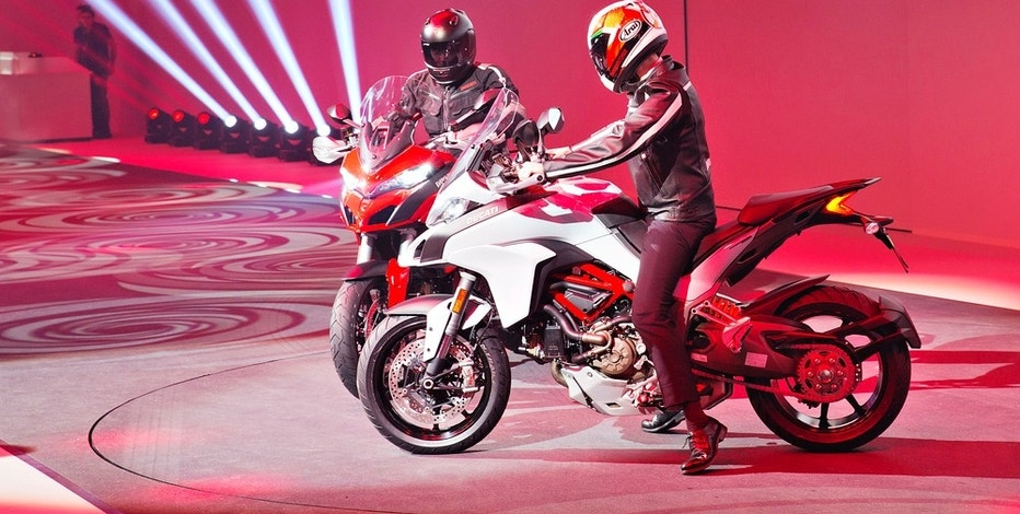 Claudio Domenicali President and CEO of Ducati presents new version of motorcycle Ducati Multistrada during the Volkswagen Group Night in Geneva on Monday March 2nd 2015