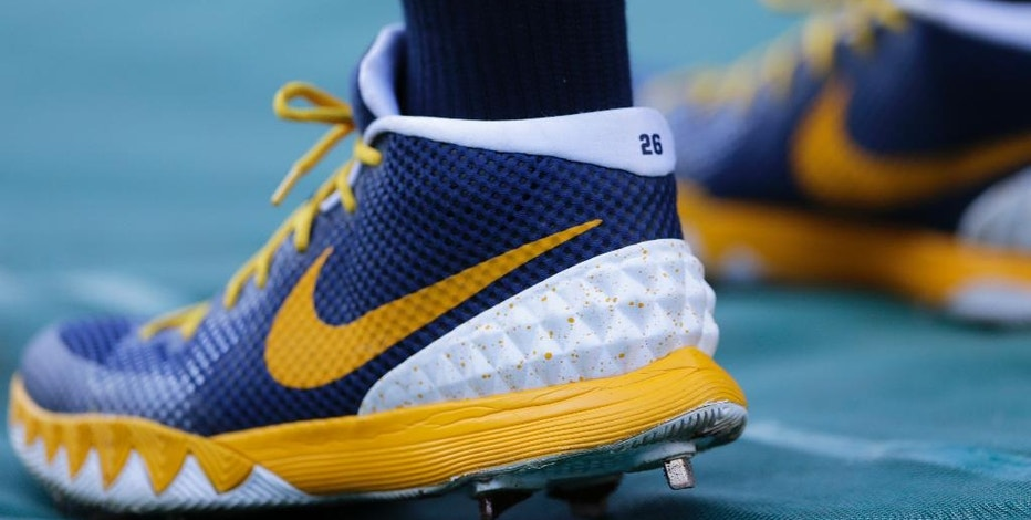 FILE - In this Tuesday, April 19, 2016, file photo, San Diego Padres third baseman Yangervis Solarte wears Nike cleats during batting practice before a baseball game against the Pittsburgh Pirates, in San Diego. Looking at which major U.S. companies pay the most tax and which pay the least, retailers and health insurers tend to pay more taxes than other companies because they do almost all their business in the U.S., where tax rates are higher. Nike makes almost 60 percent of its sales in countries other than the U.S. (AP Photo/Gregory Bull, File)