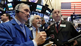 Wall St Edges Up on Strong Jobs Data, IBM Caps Gains