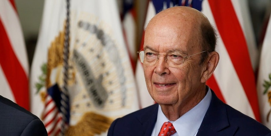 Wilbur Ross stands after being sworn in as Secretary of Commerce in Washington, DC, U.S. February 28, 2017. REUTERS/Joshua Roberts