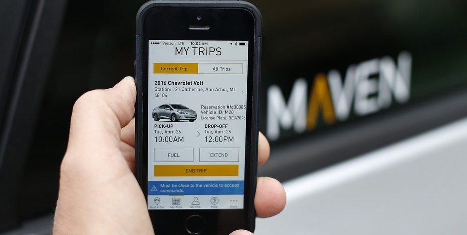 In this Wednesday, April 27, 2016, file photo, a smartphone displaying the Maven app, a General Motors car-sharing service, is shown, in Ann Arbor, Mich. General Motors Co. launched its Maven car-sharing service in New York on Monday, May 15, 2017. The service lets members rent a variety of GM vehicles for whatever they need, from a 30-minute errand to a 28-day road trip.