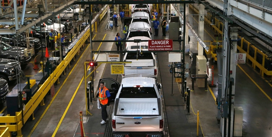 All-new Ford 2015 F-150 pickup trucks move down the final inspection line at the Ford Rouge Center in Dearborn, Michigan, November 11, 2014.