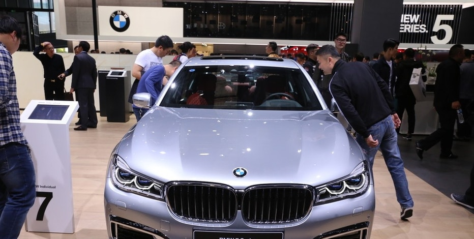 Visitors look at the BMW 7 Series on display during the 17th Shanghai International Automobile Industry Exhibition, also known as Auto Shanghai 2017, in Shanghai, China, 21 April 2017.  BMW plans to utilize more China railway services to transfer goods eastbound, BMW logistics manager said on Wednesday (3 May 2017). The German luxury automaker has been using China Railway Express(CRE) since 2011 as an alternative way to carry their goods to their plants in China, including production materials, engine parts and after-sales components, BMW's logistics and transportation planner Nobert Dierks told Xinhua.
