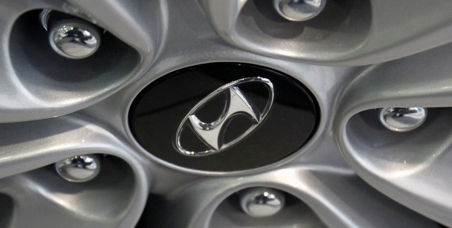 FILE PHOTO -  The logo of Hyundai Motor is seen on a wheel of a car at a Hyundai dealership in Seoul February 1, 2012. REUTERS/Kim Hong-Ji/File Photo