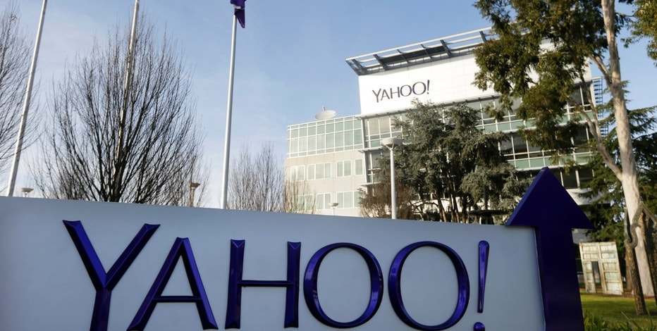 FILE - This Jan. 14, 2015, file photo shows a sign outside Yahoo's headquarters in Sunnyvale, Calif. A new lawsuit accuses Yahoo of turning its back on Chinese dissidents that it promised to help after the company fingered other activists at the request of China's government. The allegations are outlined in a lawsuit filed Tuesday, April 11, 2017, in a Washington, D.C., federal court by a group of dissidents who contend Yahoo mismanaged a $17 million fund set up to provide them with financial aid. Yahoo created the fund a decade ago after being skewered in the U.S. Congress for its conduct in China. (AP Photo/Marcio Jose Sanchez, File)