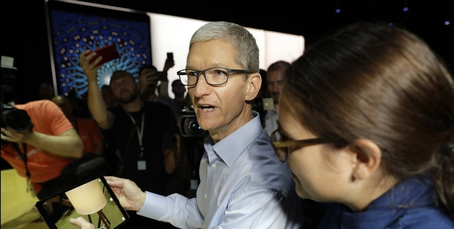 Apple CEO Tim Cook shows an iPad Pro during an announcement of new products at the Apple Worldwide Developers Conference Monday, June 5, 2017, in San Jose , Calif.