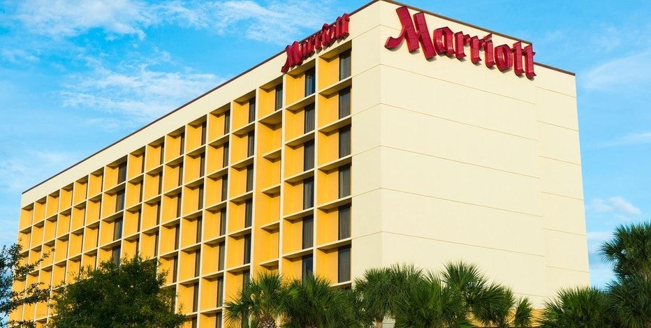 """Orlando, FL, USA - September 14, 2012: Exterior view of the Orlando Airport Marriott hotel. Marriott International has 3,700 properties in 73 countries and territories worldwide."""