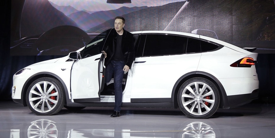 In this Sept. 29, 2015, file photo, Elon Musk, CEO of Tesla Motors Inc., introduces the Model X car at the company's headquarters in Fremont, Calif.