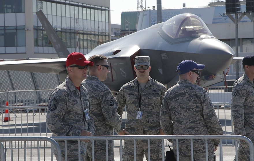U.S. servicemen gather next to a F-35 Lightning II at Paris Air Show, on the eve of its opening, in Le Bourget, east of Paris, France, Sunday, June 18, 2017. While Airbus and Boeing will again hog the spotlight at the Paris Air Show with their battle for ever-larger slices of the lucrative pie in the sky, a lot of the really interesting stuff will be going on elsewhere at next week's massive biennial aviation and defense industry gathering.