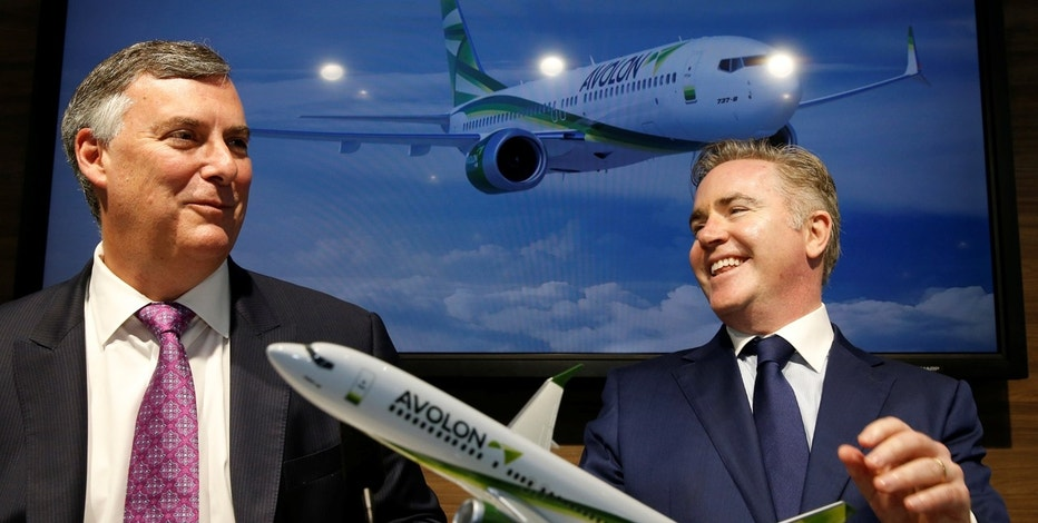Boeing Commercial Airplanes President Kevin McAllister (L) and Avolon Aerospace Leasing CEO Domhnal Slattery pose with a model of Boeing 737 MAX 10 during a commercial announcement at the 52nd Paris Air Show at Le Bourget Airport near Paris, France June 20, 2017.