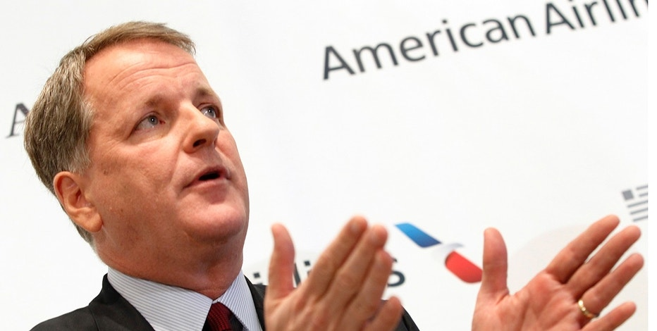 U.S. Airways CEO Doug Parker announces the planned merger of AMR Corp, the parent of American Airlines, with U.S. Airways during a news conference at Dallas-Ft Worth International Airport February 14, 2013. The $11 billion all-stock deal, announced on Thursday, would create the world's largest air carrier. REUTERS/Mike Stone  (UNITED STATES - Tags: BUSINESS TRANSPORT) - RTR3DSSX