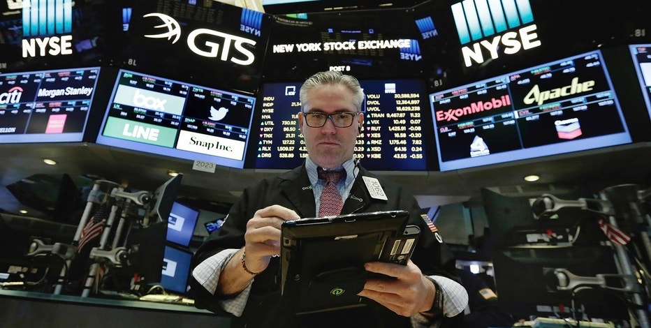 Trader Eric Schumacher works on the floor of the New York Stock Exchange, Wednesday, June 14, 2017. A weak report on retail sales sent bond yields lower and high-dividend stocks like utilities and real estate companies higher. (AP Photo/Richard Drew)