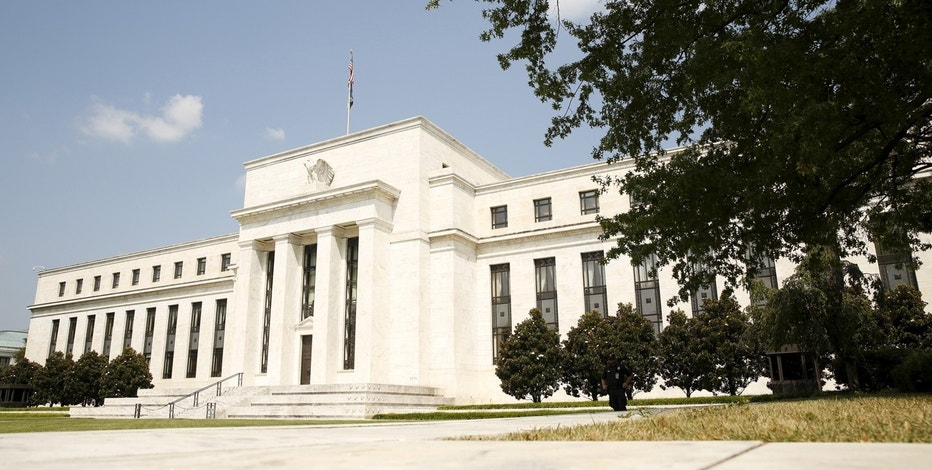 US Markets Turn Positive on Fed's Outlook for Rates