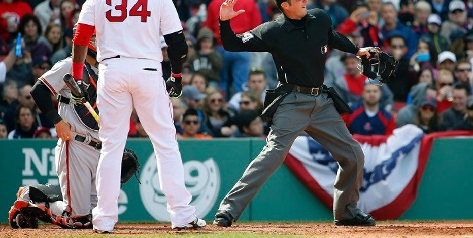 Apr 19, 2015; Boston, MA, USA; Umpire John Tumpane (74) throws Boston Red Sox designated hitter David Ortiz (34) out of the game after arguing a check swing called strike during the fifth inning against the Baltimore Orioles at Fenway Park. Mandatory Credit: Winslow Townson-USA TODAY Sports - RTR4XXGJ