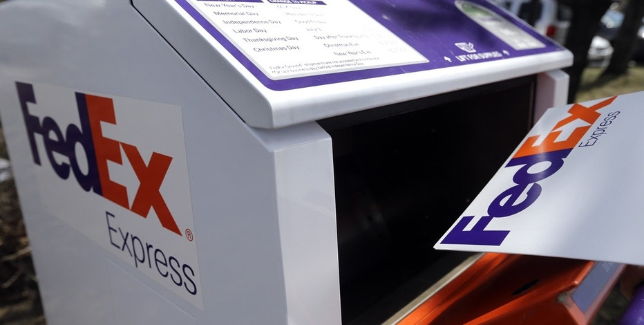 In this April 10, 2017, photo, a FedEx envelope is placed into a dropbox in North Andover, Mass. FedEx Corp. reports earnings, Tuesday, June 20, 2017.