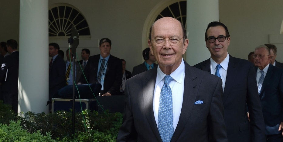 Commerce Secretary Wilbur Ross, center, and Treasury Secretary Steven Mnuchin, right, arrive to hear President Donald Trump make a statement about the U.S. role in the Paris climate change accord, Thursday, June 1, 2017, in the Rose Garden of the White House in Washington. Trump announced that the U.S. will withdraw from the agreement. (AP Photo/Susan Walsh)