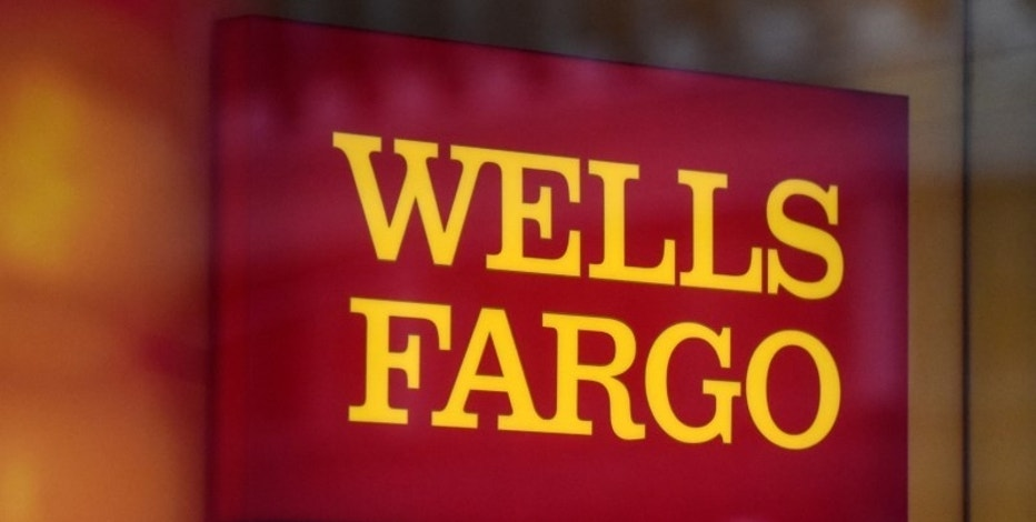 Wells Fargo tops profit forecast