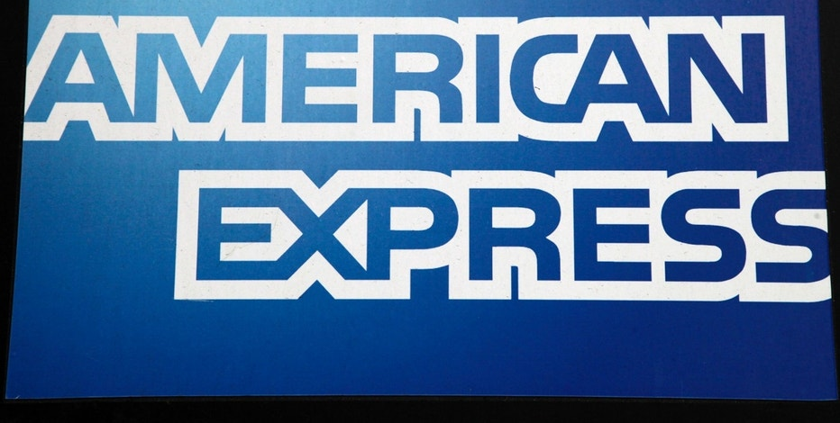 FILE - This Jan. 21, 2015, file photo, shows a sign for American Express outside a New York business. American Express Co. reports financial results, Wednesday, April 19, 2017. (AP Photo/Mark Lennihan, File)