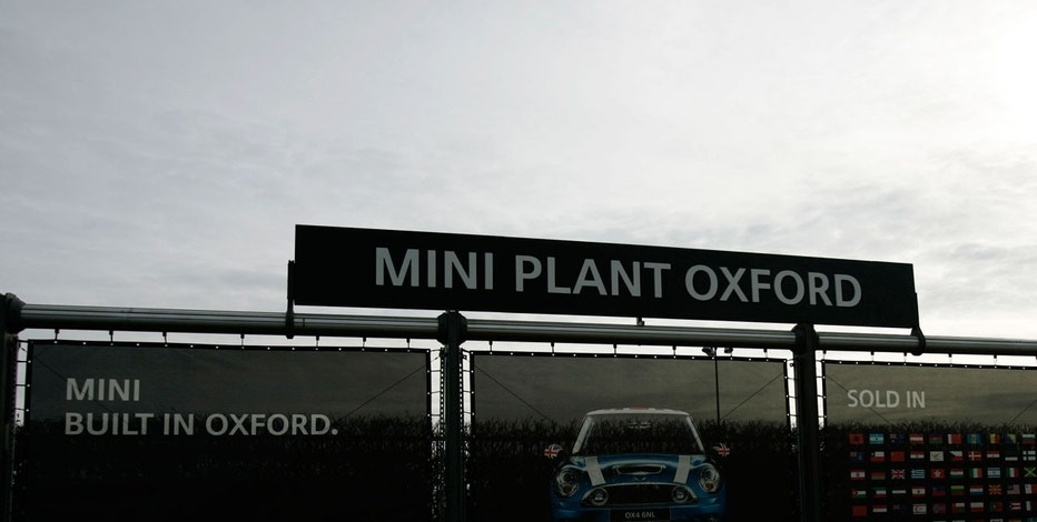 In this Feb. 16, 2009 file photo a large advertising poster for BMW Mini cars is seen outside the assembly plant in Oxford, England.