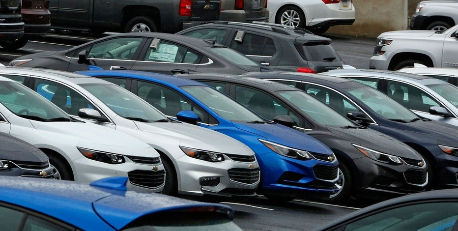 In this Thursday, Jan. 12, 2017, photo, Chevrolet cars sit on the lot of a dealer in Pittsburgh. On Monday, July 3, 2017, automakers release monthly sales reports.