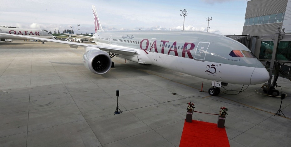 FILE -- In this Nov. 4, 2015 file photo, a Boeing 787 airplane purchased by Qatar Airways is shown during a delivery ceremony in Everett, Wash. Qatar Airways, announced Sunday, June 11, 2017, that its net profits reached $540 million in its latest financial disclosure before the airline was blocked from flying to major Arab states. Analysts estimate that a political standoff in the Gulf between Qatar and other Arab states will cost the airline heavily after Saudi Arabia, the United Arab Emirates, Egypt and Bahrain cut ties with Qatar and blocked direct flights with the country. (AP Photo/Ted S. Warren, File)