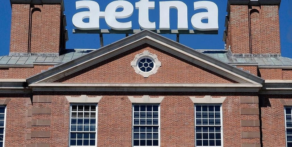 FILE - In this Tuesday, Aug. 19, 2014, file photo, a sign for Aetna Inc., sits atop a building at the company headquarters in in Hartford, Conn. Aetna reports quarterly financial results on Tuesday, Aug. 4, 2015. (AP Photo/Jessica Hill, File)